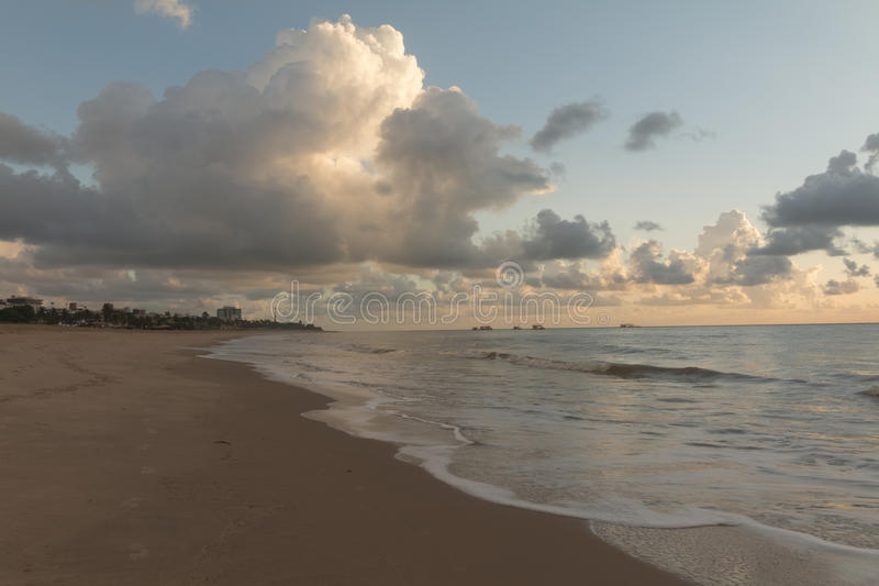 Sunrise in Cabo Branco beach - Joao Pessoa PB, Brazil. Cabo Branco beach is a place to be visited in Joao Pessoa PB. The street behind is closed in morning hours stock photos
