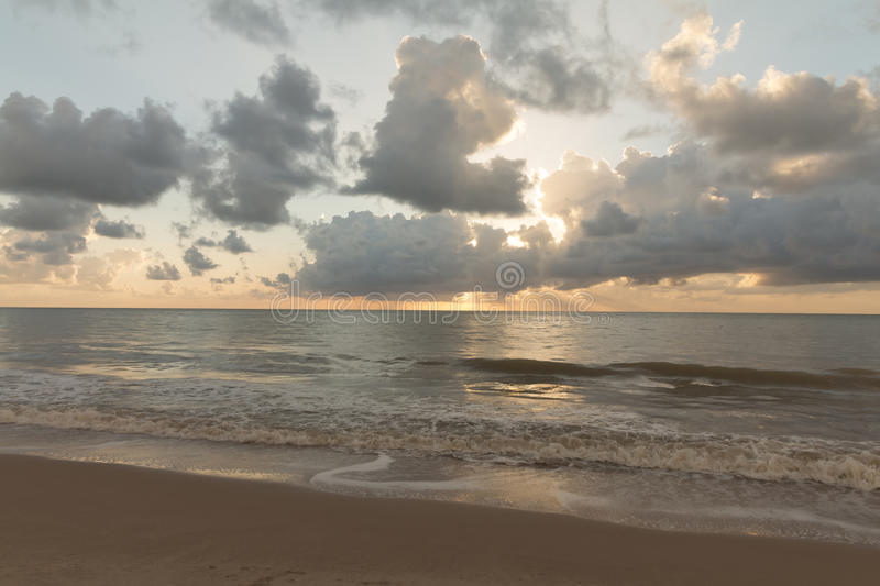 Sunrise in Cabo Branco beach - Joao Pessoa PB, Brazil. Cabo Branco beach is a place to be visited in Joao Pessoa PB. The street behind is closed in morning hours stock photo