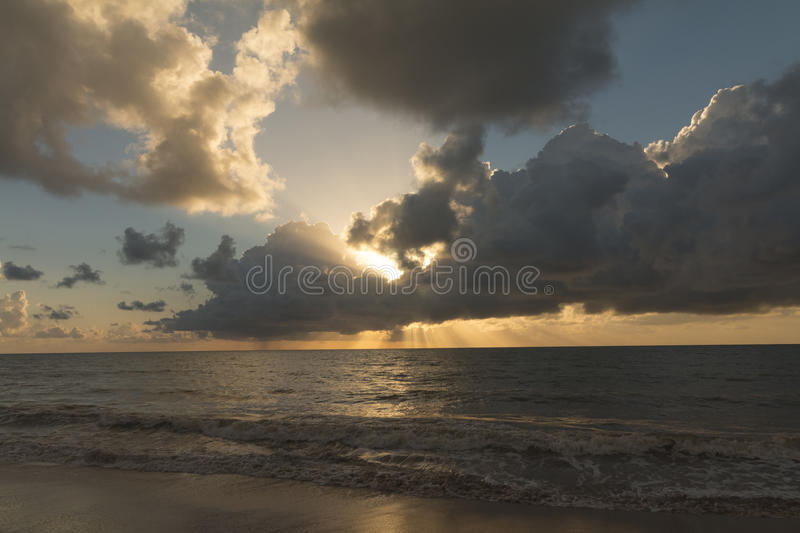Sunrise in Cabo Branco beach - Joao Pessoa PB, Brazil. Cabo Branco beach is a place to be visited in Joao Pessoa PB. The street behind is closed in morning hours stock image