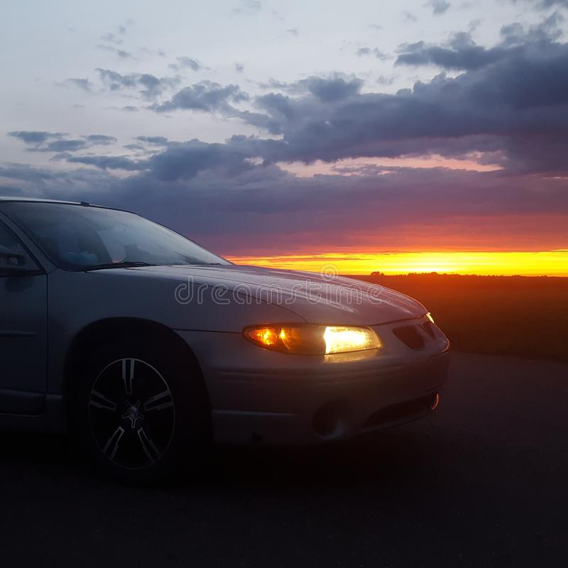 Sunrise with car stock photography