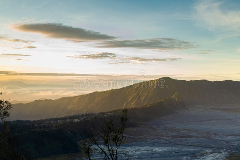 Sunrise at Cemoro lawang around bromo tengger semeru national park. Taken from love hill sunrise spot stock image