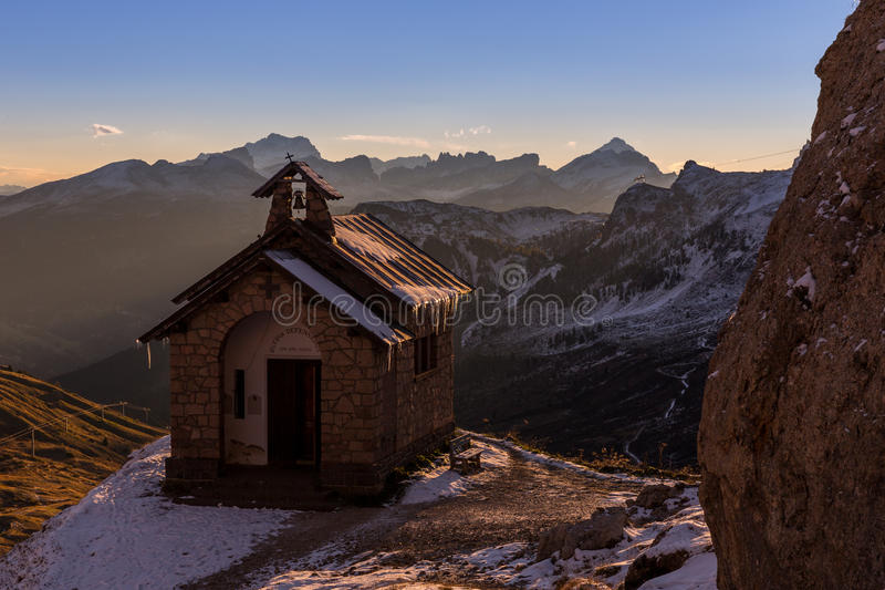 Sunrise at chapel Passo Pordoi in Dolomites in Italy stock image