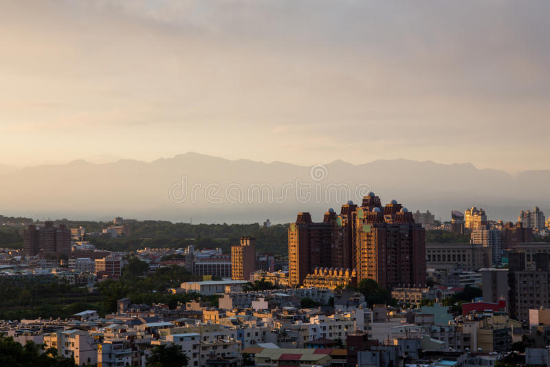 Sunrise in Chiayi city Taiwan. The sun rising over the city of Chiayi with mountains in the background stock photo