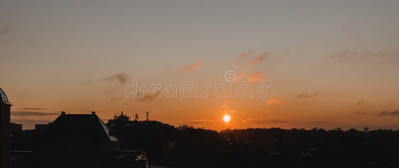 Sunrise in city. Photo of beautiful orange sunset, silhouette of lebanese city in sunrise. Warm weather, romantic. Vacation stock photo