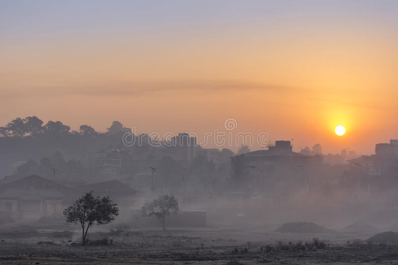 Sunrise at the city. A photograph of the sunrise at the city of Kathmandu, as seen from Gaushala stock photography
