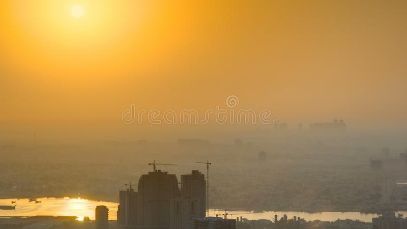 Sunrise with Cityscape of Ajman from rooftop timelapse. Ajman is the capital of the emirate of Ajman in the United Arab Emirates. stock photos