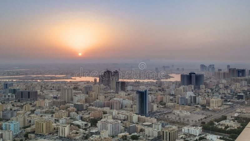Sunrise with Cityscape of Ajman from rooftop timelapse. Ajman is the capital of the emirate of Ajman in the United Arab Emirates. stock images