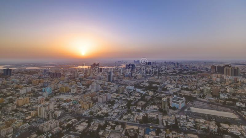 Sunrise with Cityscape of Ajman from rooftop timelapse. Ajman is the capital of the emirate of Ajman in the United Arab Emirates. stock photo