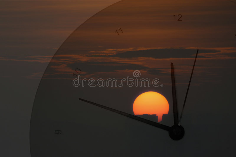 Sunrise and Clock royalty free stock image