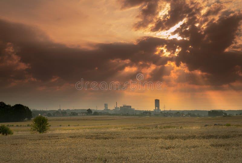 Sunrise above coal mine. Sunrise coal mine sun emition nature environment stock image