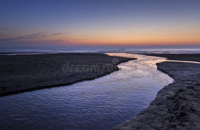 Sunrise on the coast of the Caspian Sea stock image