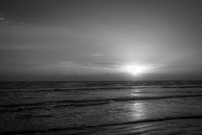 Sunrise on the coast of Cyprus sun rising over the Mediterranean Sea. Black & White Sunrise on the coast of Cyprus, with the sun rising over the Mediterranean stock photos