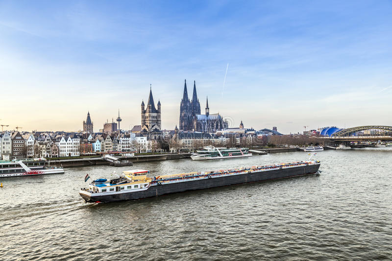 Sunrise in cologne with Dome and river Rhine. And freight boat stock photo