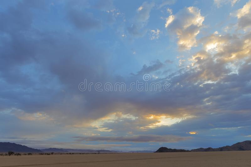 Sunrise color clouds at different altitudes. Namibia stock photos