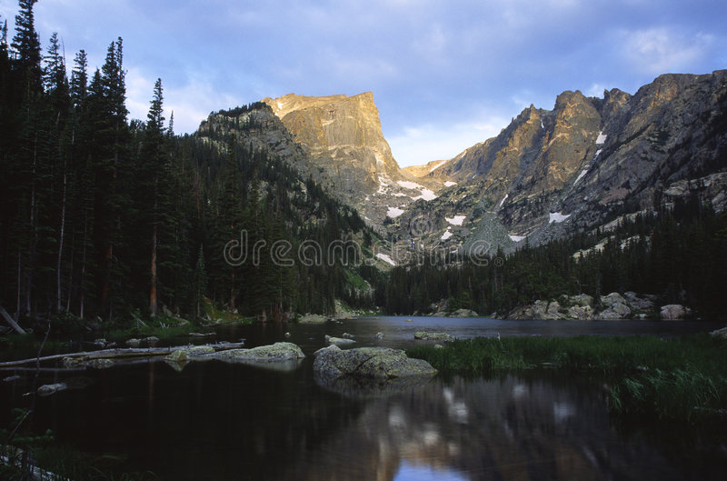 Sunrise in Colorado Rocky Mountains. Sunrise over calm alpine lake in Colorado Rocky Mountains stock photo