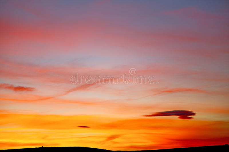 Sunrise in colored sky white sof abstract. Sunrise in the colored sky white soft clouds and abstract background royalty free stock photo