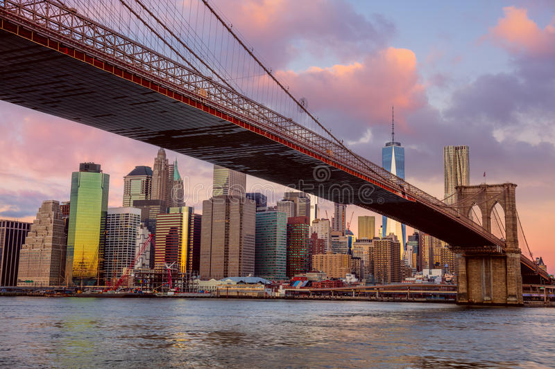 Sunrise colors of Brooklyn Bridge and Manhattan in New York City stock image