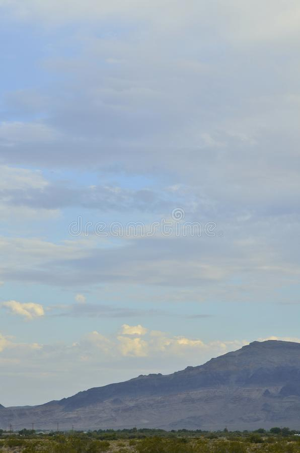 Sunrise clouds over Mojave Desert mountains valley town Pahrump, Nevada, USA stock photography