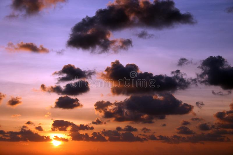 Sunrise WIth Dark Clouds and bright multi color. Sky.Picture taken on the water form a boat royalty free stock images