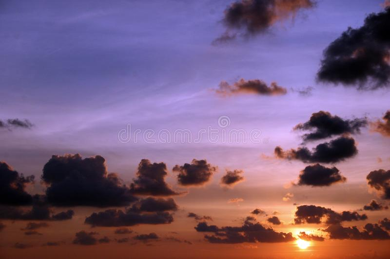 Sunrise WIth Dark Clouds and bright multi color. Sky.Picture taken on the water form a boat royalty free stock photos