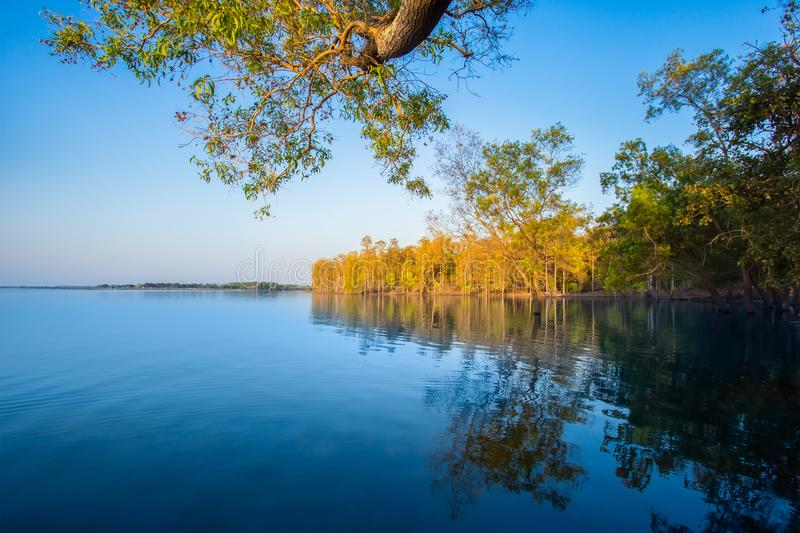 Sunrise - Dawn, Lake, Dawn, Sun, Riverbank. Flooding in rural areas. Panorama of village landscape with views of the river and the trees in the water. Flooding royalty free stock photos