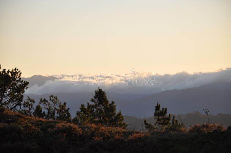 Mount Ulap, mt Ulap, Cordillera Mountain, Cordillera mountain ranges, Sea of Clouds, itogon, Benguet, Philippines,, Luzon. Sunrise at dawn over the Cordillera stock photography