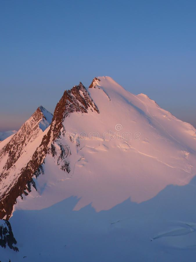 Sunrise over the Swiss Alps near Saas Fee on a beautiful winter day royalty free stock image