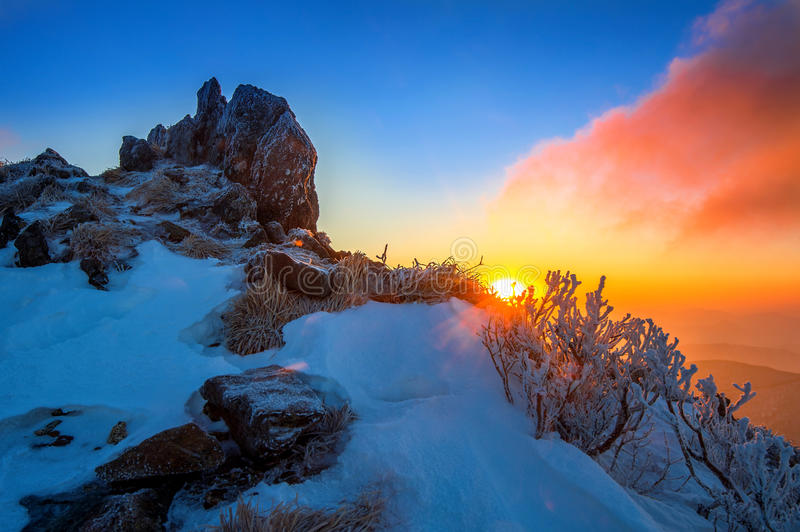 Sunrise on Deogyusan mountains covered with snow in winter,korea. royalty free stock photo