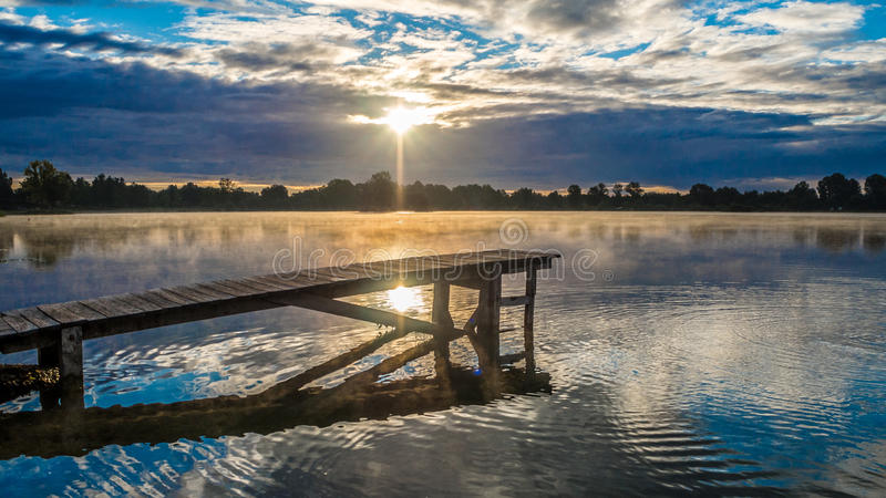 Sunrise and diving board royalty free stock images