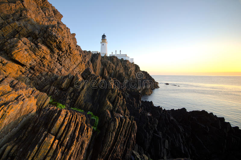 Sunrise at Douglas Lighthouse with Cliffs stock photo