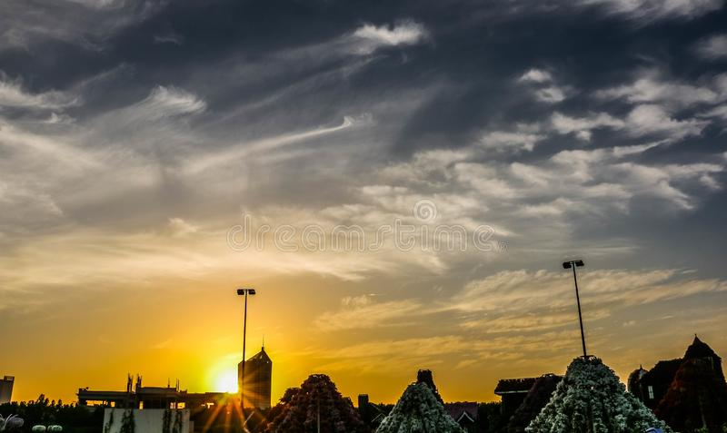 Sunrise dramatic blue sky with orange sun rays breaking through the clouds. Nature background. Hope concept. Sunrise dramatic blue sky with orange sun rays royalty free stock images