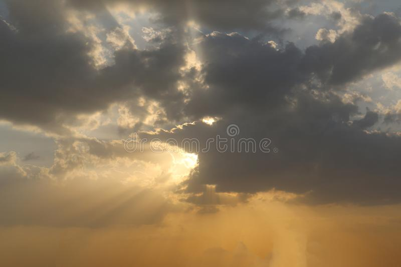 Sunrise dramatic blue sky with orange sun rays breaking through the clouds. Nature background. Hope concept. Sunrise dramatic blue sky with orange sun rays royalty free stock photos