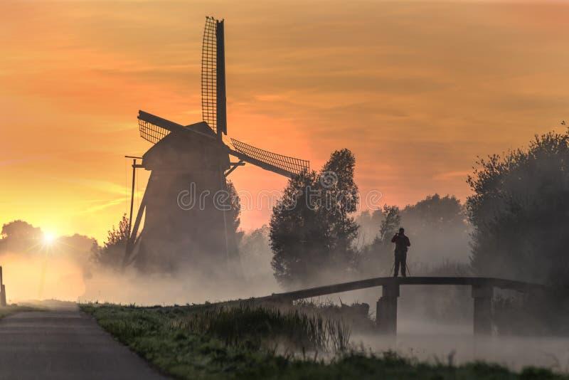 Sunrise on the Dutch windmill royalty free stock image