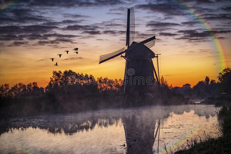 Sunrise on the Dutch windmill stock image