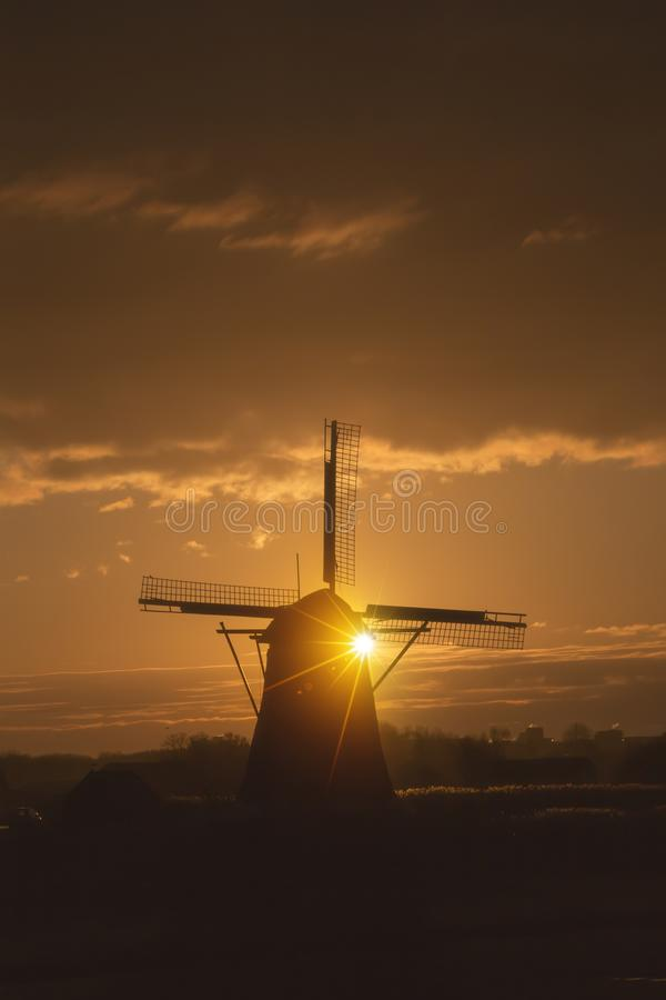 Sunrise on the Dutch windmill stock images