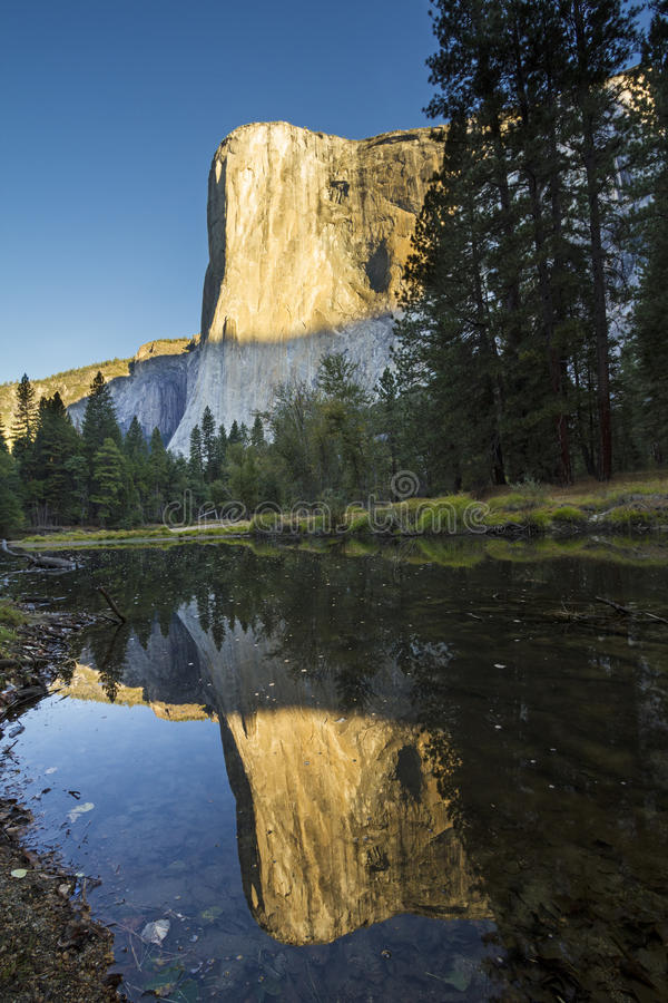 Sunrise on El Capitan. El Capitan is a vertical rock formation in Yosemite National Park, located on the north side of Yosemite Valley, near its western end stock photo