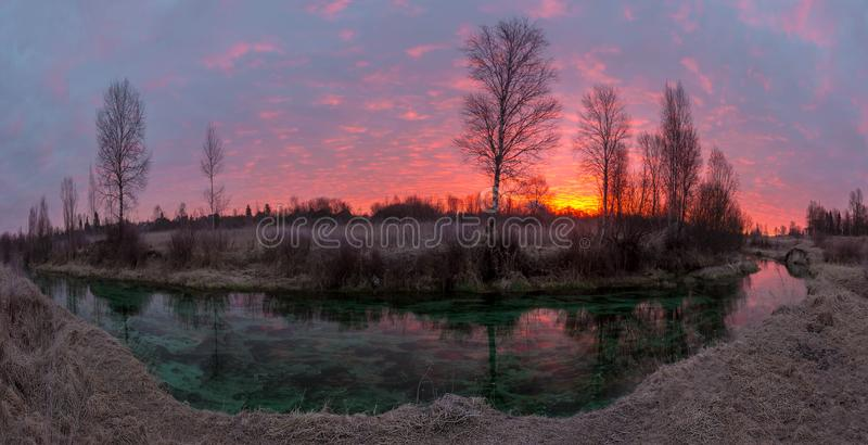 Sunrise on the emerald river royalty free stock photos