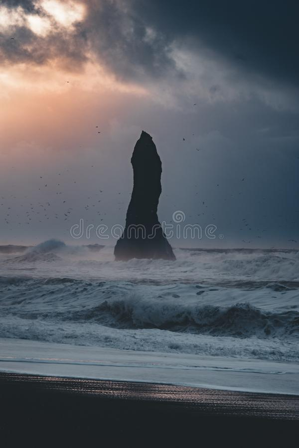 Sunrise at famous Black Sand Beach Reynisfjara in Iceland. Windy Morning. Ocean Waves. Colorful Sky. Morning Sunset. stock image