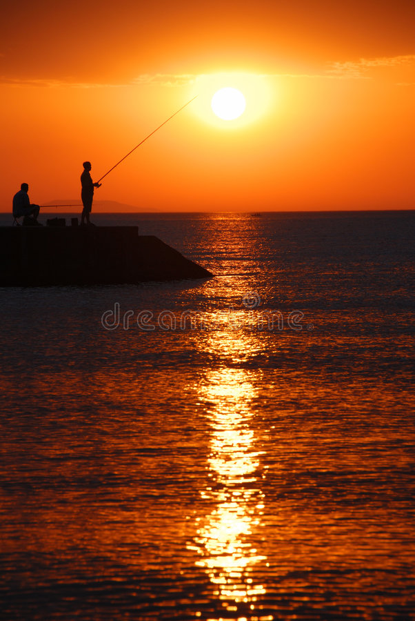 Sunrise fishing royalty free stock image