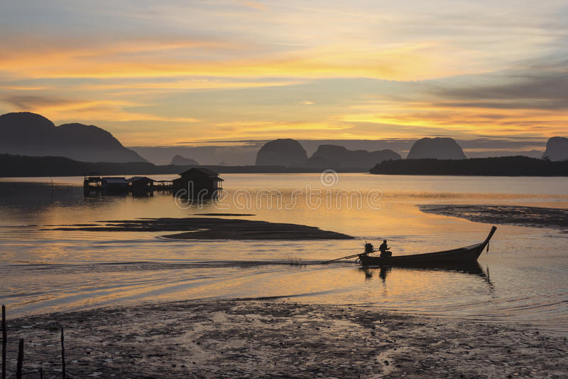 Sunrise At the fishing village stock photos