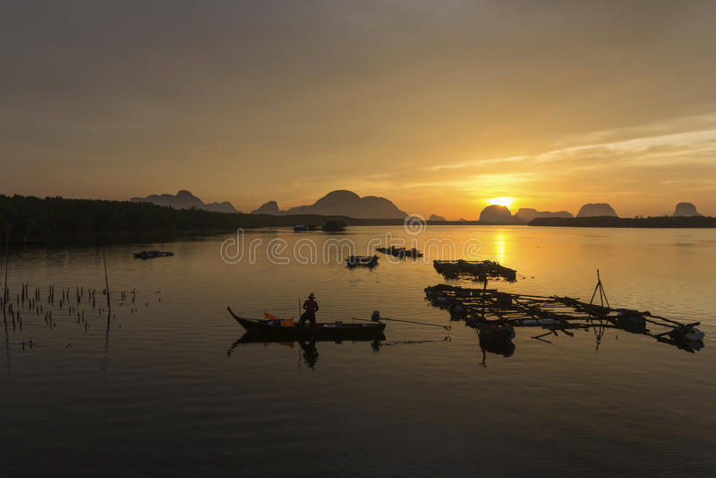 Sunrise At the fishing village stock photo