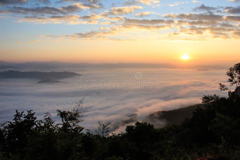 Sunrise and fog stock photos