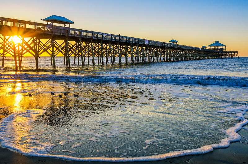 Download Sunrise, Folly Pier SC stock photo. Image of first, sunshine - 42174688