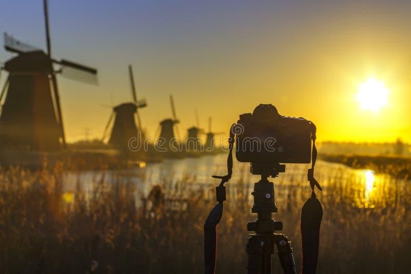 Sunrise on the frozen windmills alignment royalty free stock photo