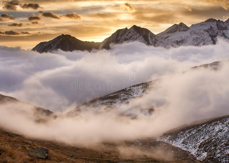 Sunrise in Gran Paradiso National Park Italy. Sunrise in National Park Gran Paradiso. Beautiful sunrise scenery. Mist during sunrise in Alps Italy, beautiful stock photo