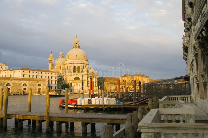 Sunrise On The Grand Canal Venice. The sun is just beginning to blaze as Venice, Italy awakens stock image