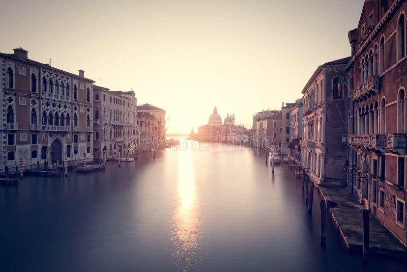 Sunrise on Grand Canal in Venice. Beautiful sunrise over the Grand Canal in Venice looking towards the Basilica di Santa Maria della Salute stock photo