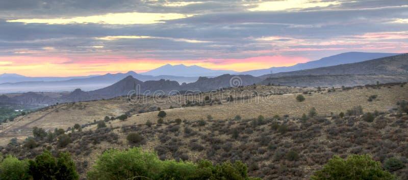 Sunrise Granite Dells Mountains, Prescott, Arizona USA. View from the Prescott Resort Hotel of the granite cliffs and boulders of Watson Lake and distant stock image