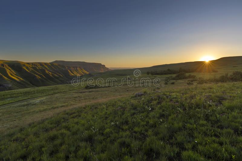 Sunrise in a green valley. Drakensberg South Africa stock photography