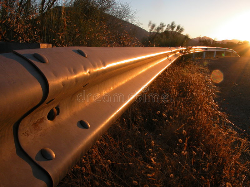 Sunrise on a guardrail stock images